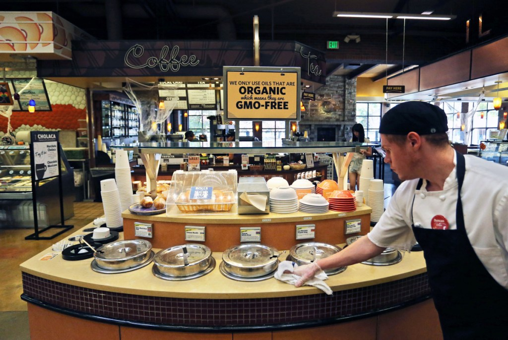 An employee wipes down the soup bar at a store in Boulder, Colo., that promotes and sells organic products. The Cornucopia Institute, a farm policy research group, says it has found significant variation in what is designated as organic.