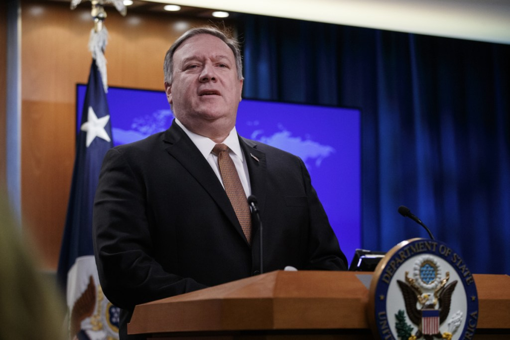 "Secretary of State Mike Pompeo speaks during a news conference Friday at the State Department in Washington. He played down tensions with North Korea, saying he expects that the two sides will continue ""very professional conversations."""