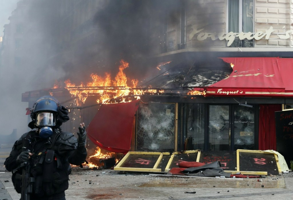 Paris' famed restaurant Fouquet's burns on the Champs Elysees avenue during a yellow vests demonstration Saturday.
