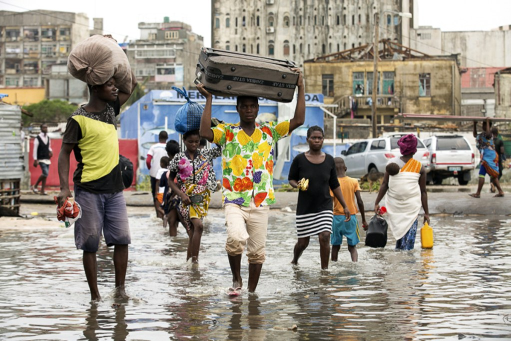 People head for higher ground in Beira, Mozambique, on Friday after Cyclone Idai made landfall. The storm was considered by some to be the worst in more than 20 years.