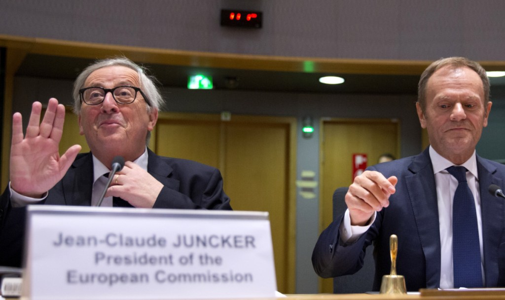 European Commission President Jean-Claude Juncker, left, and European Council President Donald Tusk prepare to open a meeting at the Europa building in Brussels, on Wednesday