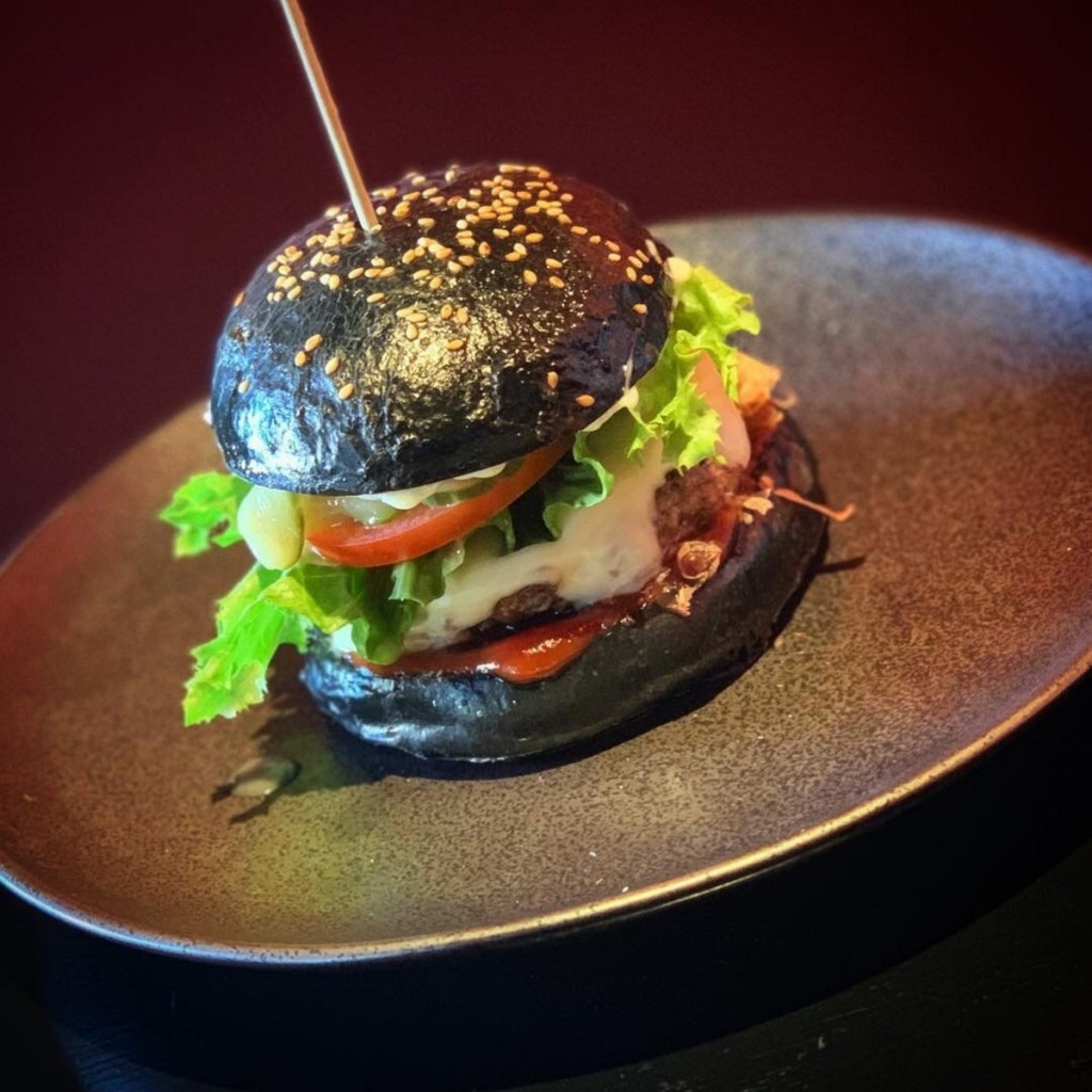 The Big Mami Burger, made with a squid ink brioche bun.