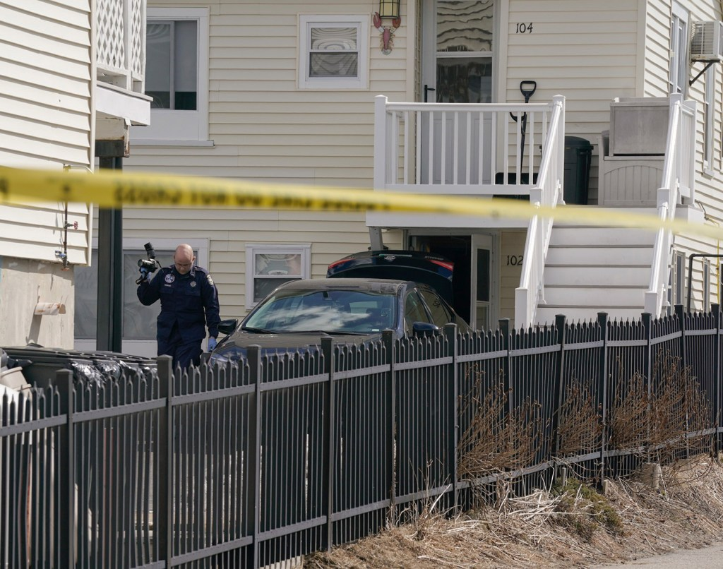 A Maine State Police investigator works at the scene of William Popplewell's death near 5 Boisvert St. in Old Orchard Beach on Tuesday.