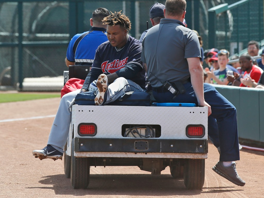 Cleveland's Jose Ramirez is taken off the field on a cart after fouling a ball off his leg duruing the Indians' spring training game against Chicago on Sunday in Glendale, Arizona. X-rays were negative but Ramirez's status for Opening Day is uncertain.