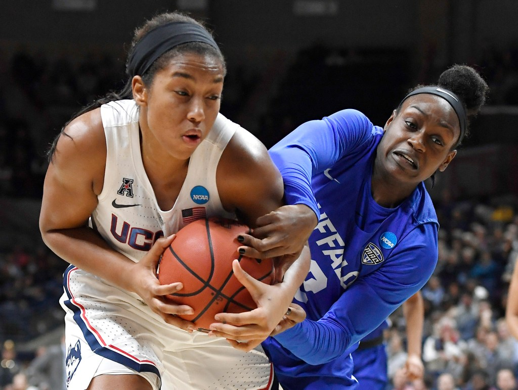 Buffalo's Brittany Morrison, right, pressures UConn's Megan Walker during the Huskies' 84-72 win in the second round of the NCAA tournament on Sunday in Storrs, Connecticut.