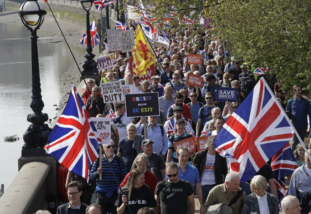 """Pro-Brexit supporters take part in the final leg of the """"March to Leave"""" along the embankment in London on Friday."""