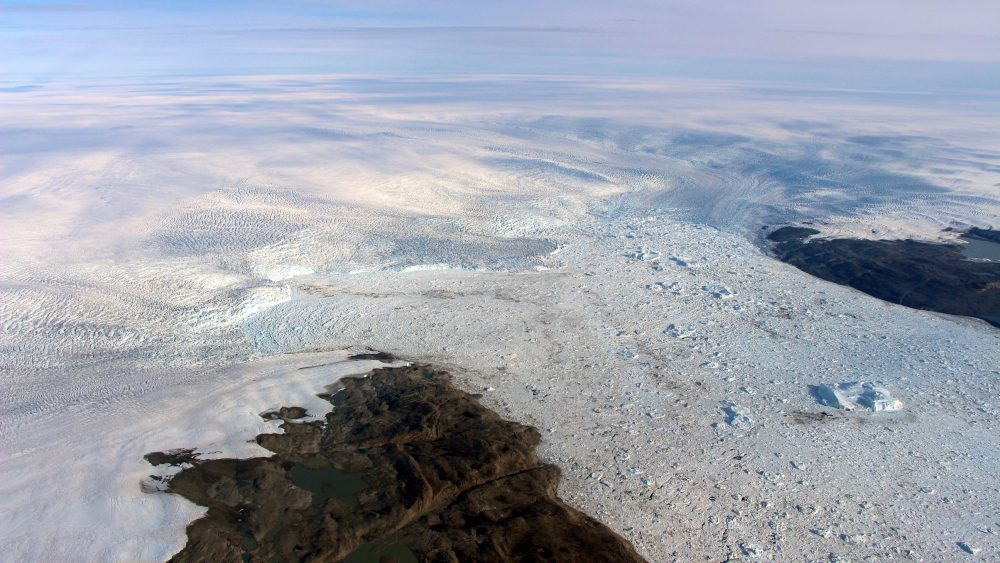 This 2016 photo provided by NASA shows patches of bare land at the Jakobshavn glacier in Greenland. The major Greenland glacier, which was one of the fastest-shrinking ice and snow masses on Earth, is growing again, a new NASA study finds
