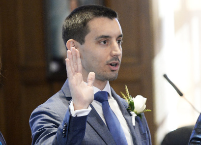 Portland City Councilor Justin Costa, shown being sworn in December 2017, is a candidate for mayor.
