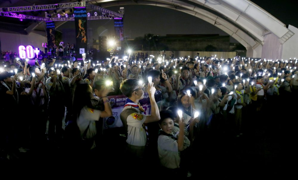 Philippine Boy Scouts switch on their flashlights at the countdown for the 12th Earth Hour event Saturday in Manila, Philippines. Earth Hour is the symbolic switching off of the lights for one hour to help minimize fossil fuel consumption as well as mitigate the effects of climate change.
