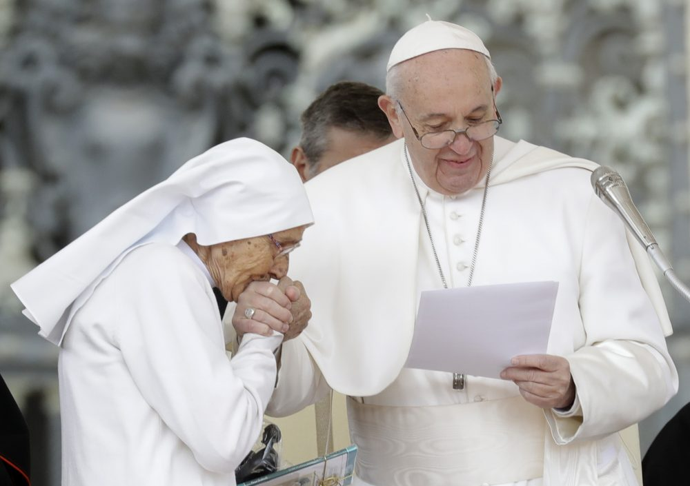 85-year-old sister Maria Concetta Esu kisses the hand of Pope Francis during his weekly general audience in St. Peter's Square on Wednesday.