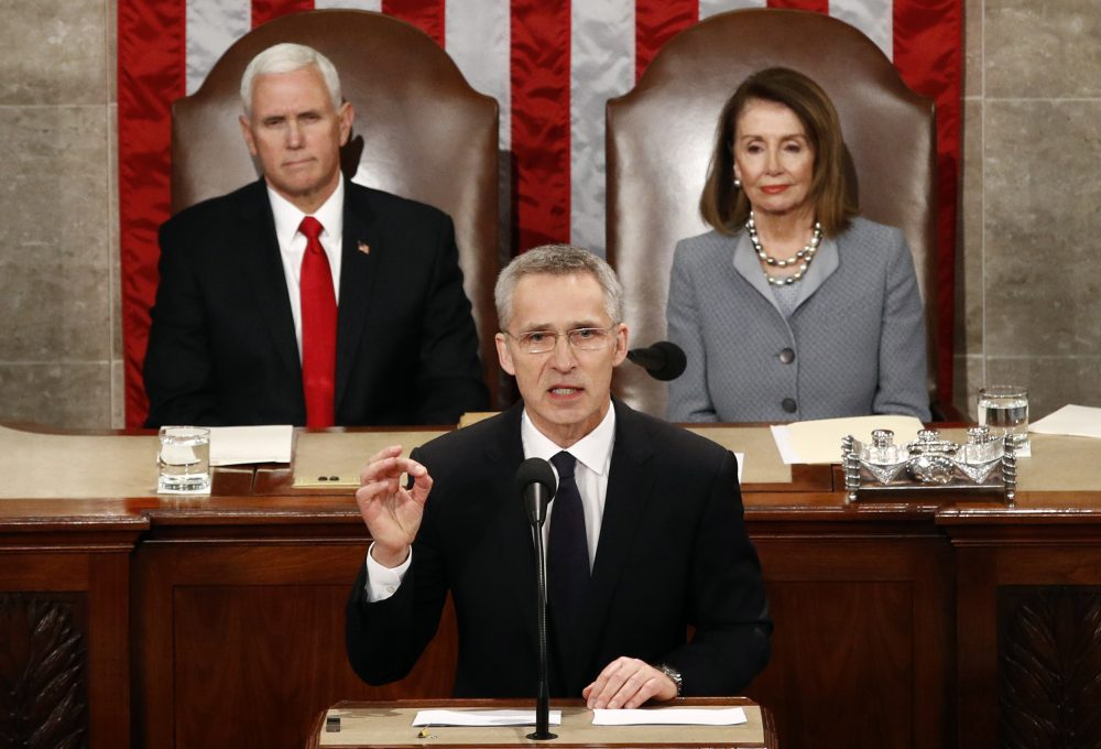 NATO Secretary General Jens Stoltenberg, standing in front of Vice President Mike Pence and House Speaker Nancy Pelosi of California, addresses a joint meeting of Congress on Capitol Hill in Washington on Wednesday.