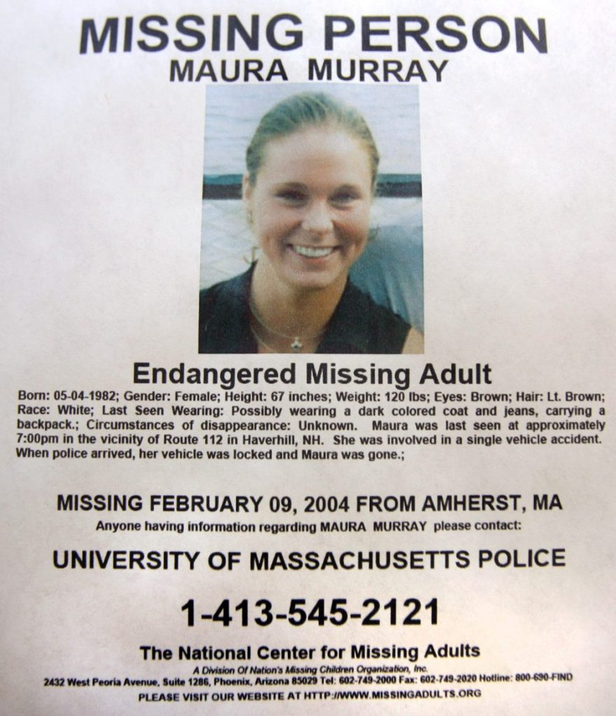 This Feb. 4, 2014 photo shows a missing person poster of Maura Murray that hangs in the lobby of the police station in Haverhill, N.H. Authorities are in an area of the northern New Hampshire town on Wednesday, April 3, 2019, related to an ongoing investigation into her disappearance in 2004.