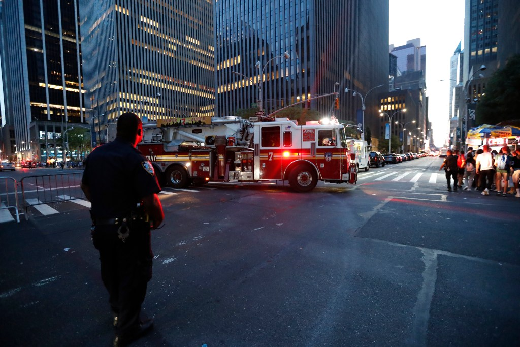 Fire trucks respond during a widespread power outage in the Manhattan borough of New York on Saturday.