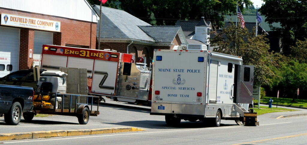 A suspicious package discovered in front of the Dixfield Town Office Friday morning turned out to be newsletters for the town from a printer, according to interim Dixfield Police Chief Ron Wood.