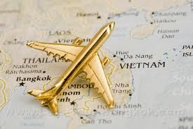 gold plane pin on map of thailand