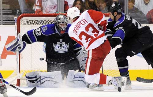 Detroit Red Wings center Kris Draper scores on Los Angeles Kings goalie Jonathan Quick as defenseman Kyle Quincey, right, tries to defend during the second period. Mark J. Terrill / Associated Press