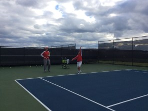 Cornell Assistant Coach Bruno Santarelli watches senior Stefan Vinti practice.