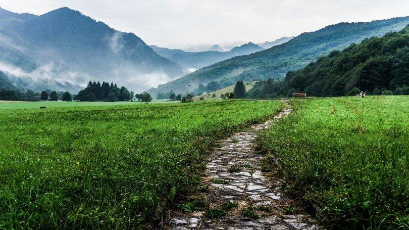 cobblestone path through fields dungeons dragons journey exploration