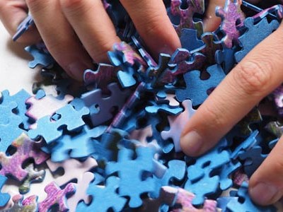 Holding touching puzzle pieces