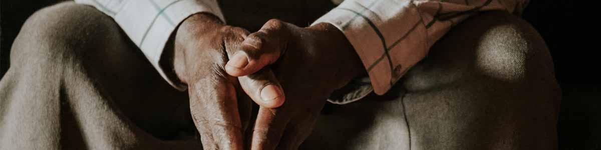 Man's handing folded in prayer
