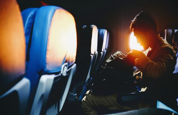 8 Simple Stretches You Can Do in an Airplane