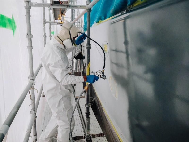 Multitech Technician Performing Paint Job on Yacht