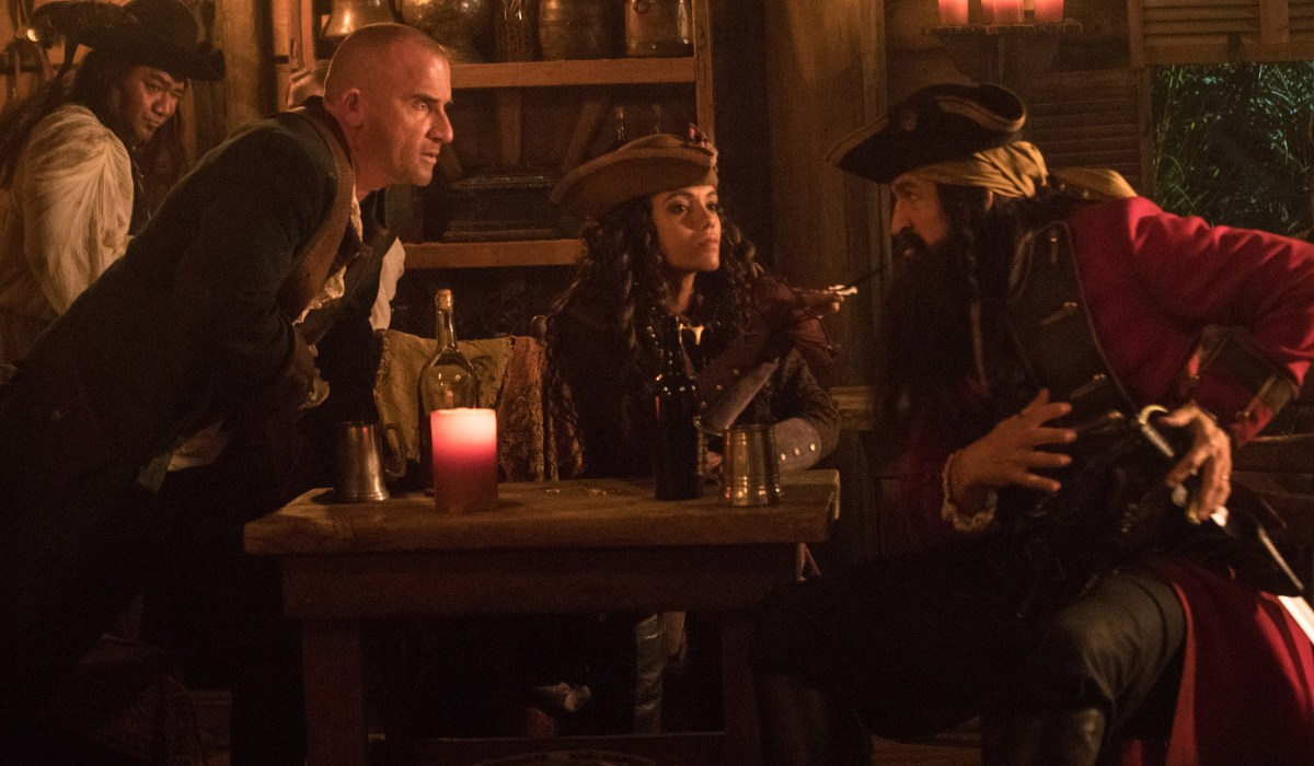 "DC's Legends of Tomorrow -- ""The Curse of the Earth Totem"" -- Image Number: LGN312b_0058b.jpg -- Pictured (L-R): Dominic Purcell as Mick Rory/Heat Wave, Maisie Richardson- Sellers as Amaya Jiwe/Vixen and Jonathan Cake as Blackbeard -- Photo: Jack Rowand/The CW -- © 2018 The CW Network, LLC. All Rights Reserved."