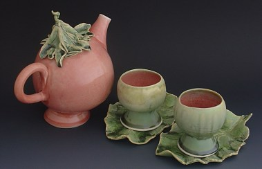 Leaf-Capped Teapot Lady with Melon Mugs