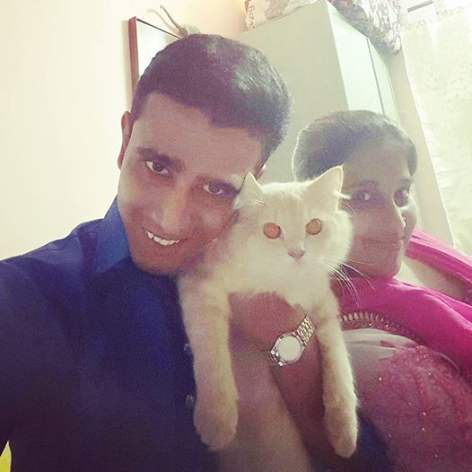 Photo of Faraaz Kazi, cat Sugar and Aasiya Kazi