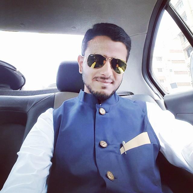 Faraaz Kazi in his car on the way to his workshop