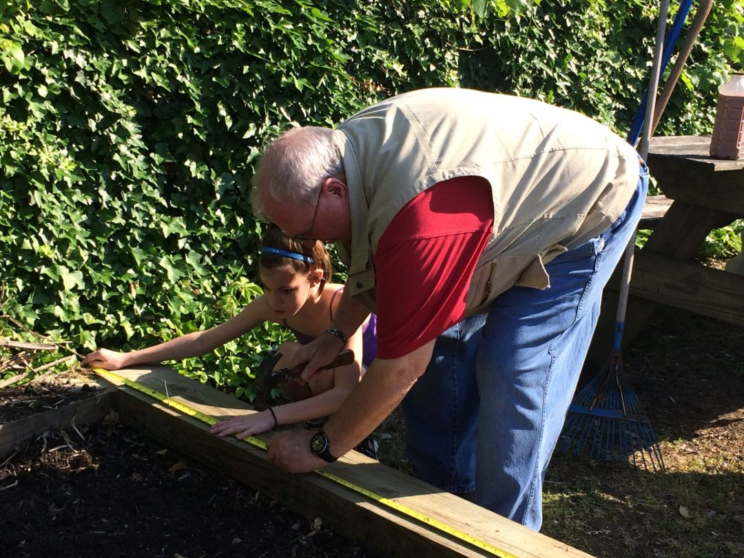 gs-co-leader-steve-moore-helps-with-the-girl-scout-garden