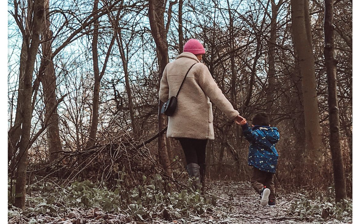 mother and son walking in a forest