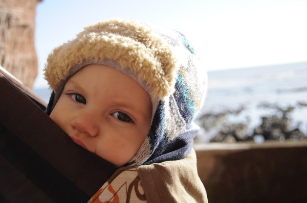 tucked up nicely in the CatBirdBaby sling on a sunny winter Devon beach stroll by Mum in a nutshell