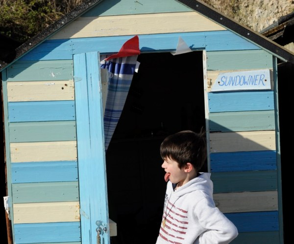 Hide and seek during a winter picnic on a Devon beach