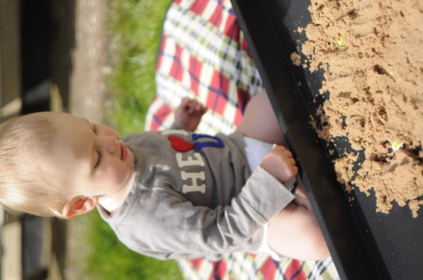 Homemade sand pit for a baby sensory play session