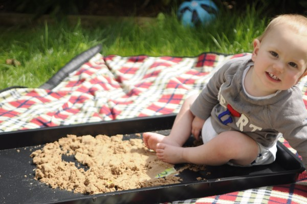 A homemade sand pit for an out door baby  sensory play session