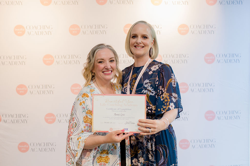 Annie Love graduating as a life coach, pictured with Julie Parker from the Beautiful You Coaching Academy.