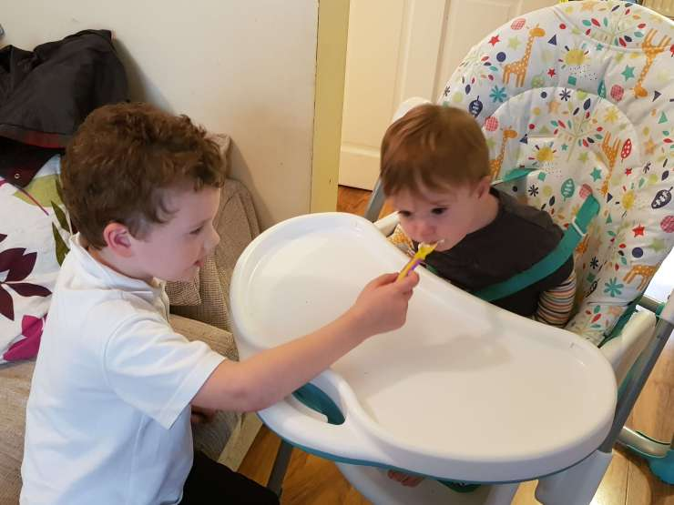 boy-feeding-sibling