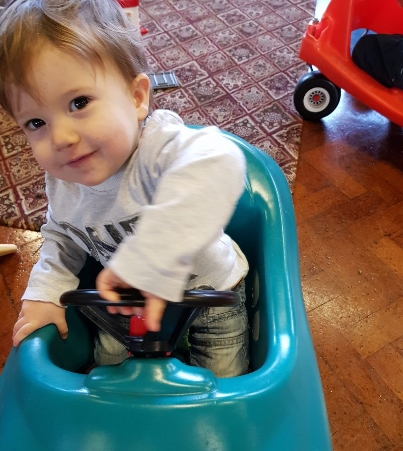 toddler-in-toy-car-at-a-playgroup