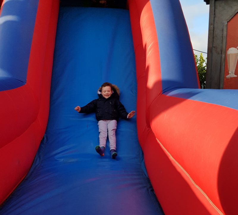 boy-sliding-down-bouncy-slide