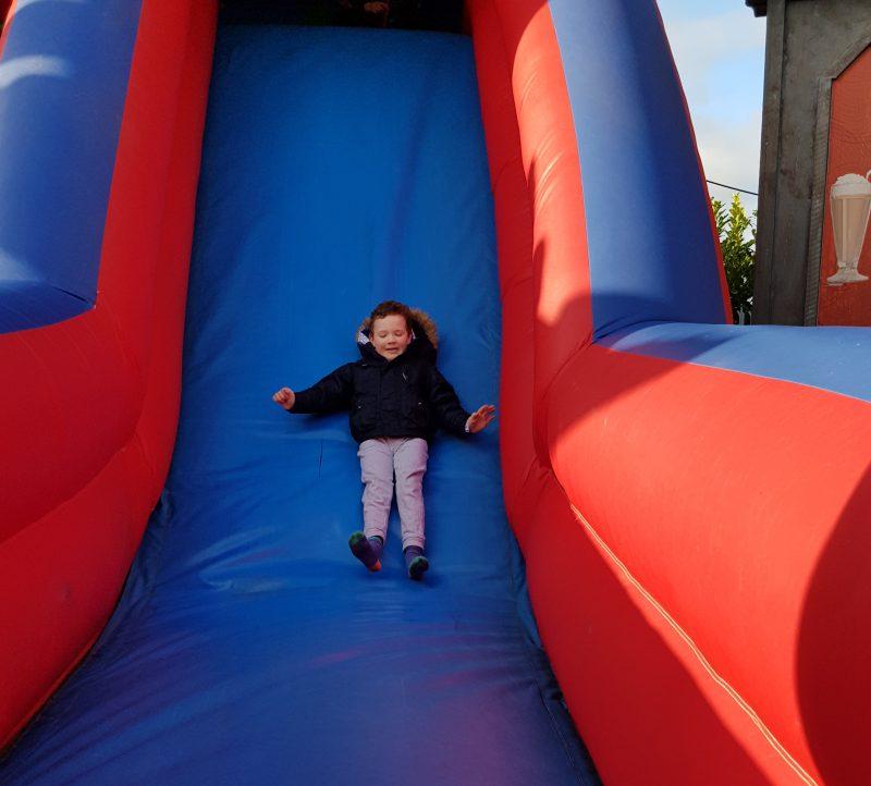 boy-sliding-down-bouncy-slide