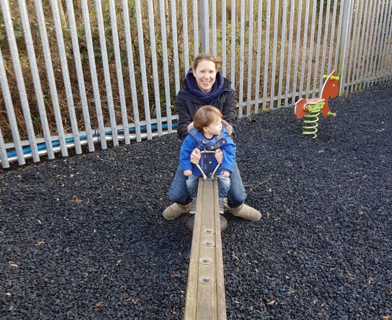 mother-and-toddler-son-on-seesaw