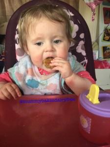 Little one enjoying a falafel bite