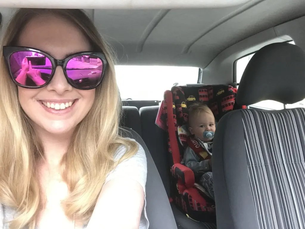 me sat in the front of the car and dexter sitting in the back in his forward facing car seat. why we use a forward facing car seat