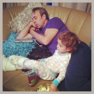exhausted dad with toddler