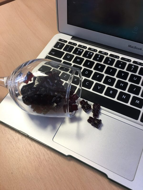 spilled my red wine gummies onto my laptop!