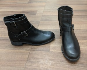 Black ankle boots with buckle details