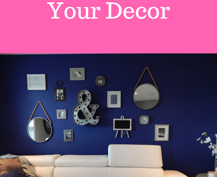 Living room decor - a blue wall with white sofa and several items of wall art
