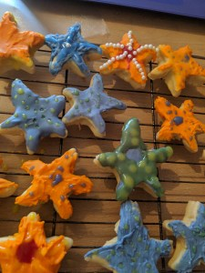 Iced starfish cookies on a tray