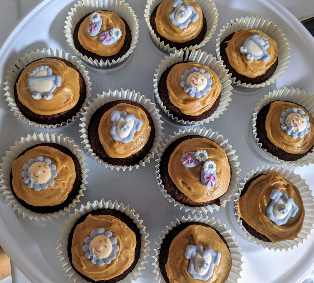 Chocolate and salted caramel baby boy cupcakes
